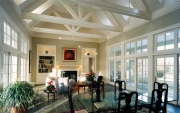 Dining/Living Room with views to west and east, site built trusses with concealed indirect lighting