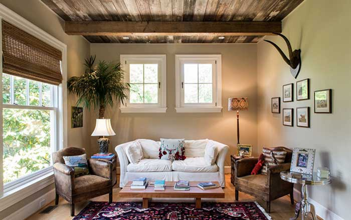 Guest living area with reclaimed beams and ceiling